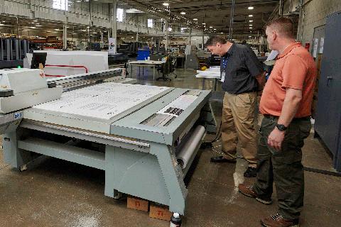 Man-Teaching-Wide-Format-Printing-Image